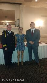 EMT Kluczynski receiving a clinical save commendation
