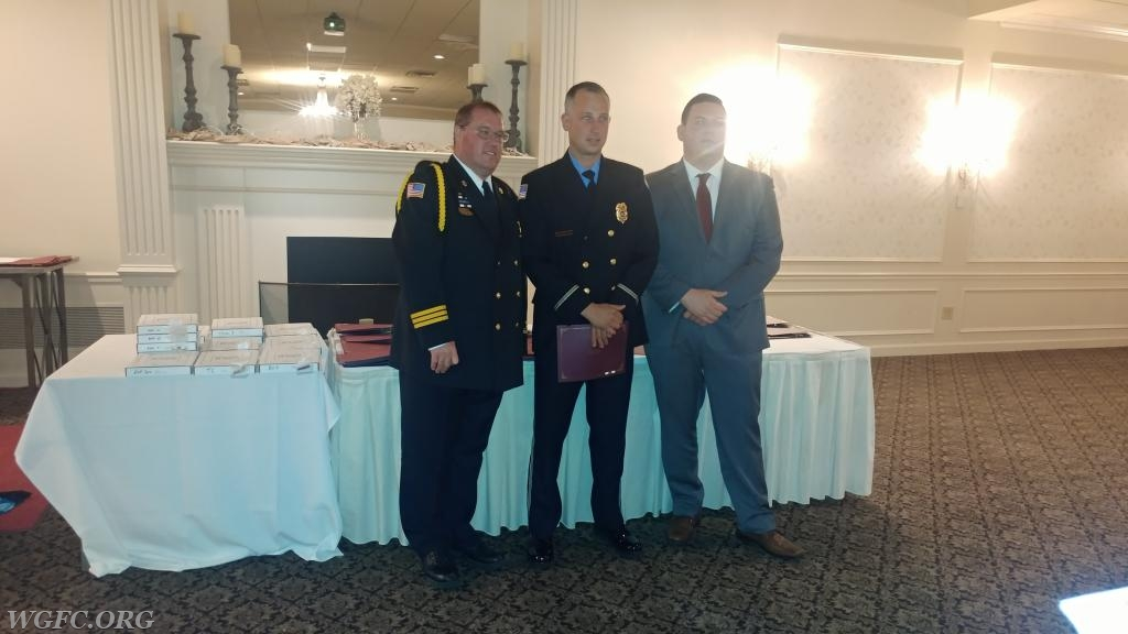 Firefighter Dan O'Connell receiving a clinical save commendation