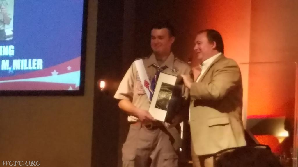 State Representative John Lawrence presents Chris with a proclamation.