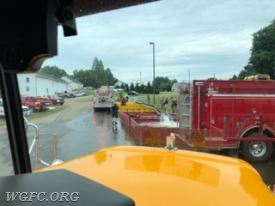 This photo shows Tanker 22 approaching the dump site, with two tankers already dumping water.