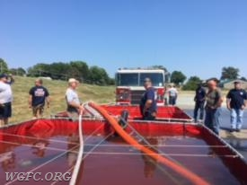 In the practical session on day one, crews learned the art of transferring water from portable tank to tank.