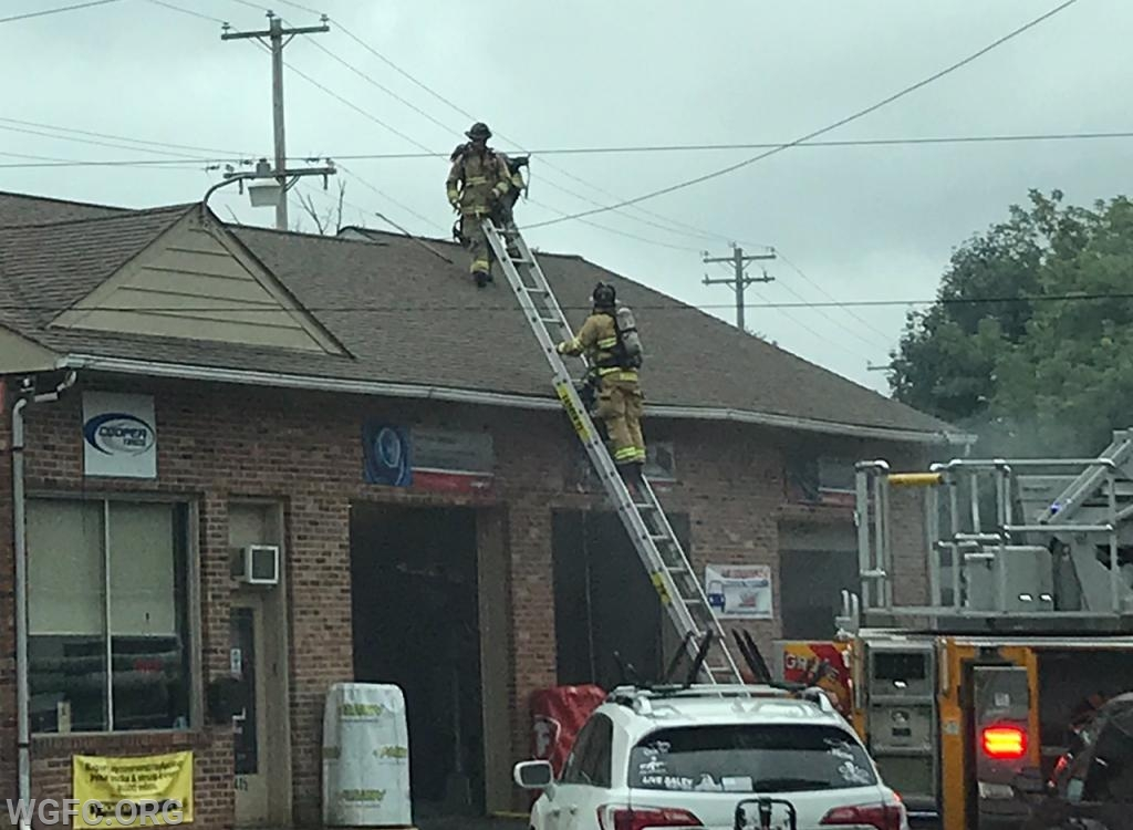 Firefighters go to the roof to check for extension.
