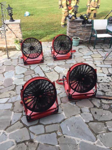 Four positive pressure fans in service to clear the house of heat and smoke.