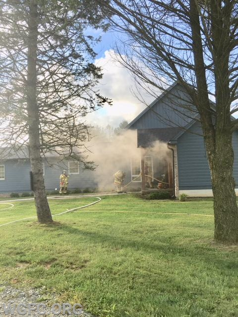 West Grove Engine 22-2 crews make entry to this Saginaw Road house fire on Saturday.  Quick work limited damage at this fire.