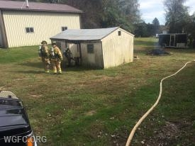 WGFC firefighters check for fire in a shed on Den Road in Franklin Township.  The small fire was quickly extinguished.