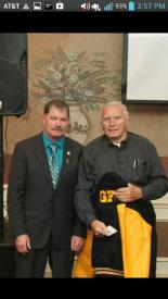 Former WGFC President and Chief Emeritus John Chambers presented a fire company jacket and 70 year service pin to Past Chief Willis in October, 2013
