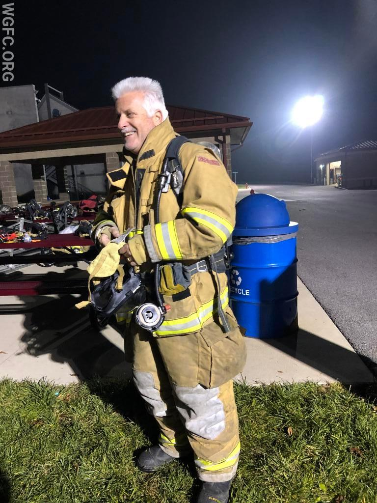 Firefighter Bill Wohl donning his turnout gear