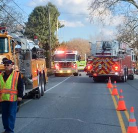 Apparatus along busy Old Baltimore Pike, as Ladder 21 departs