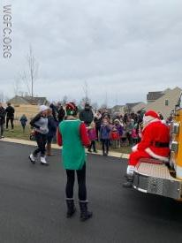 Dozens wait for a turn to tell Santa what they want this holiday season.