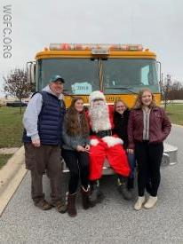 Families gather for an annual picture with Santa -- the Deglers of Penn Township have been holding a community gathering in the Estates of London Brook for more than ten years.