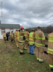 A large group of WGFC firefighters observe the operation.