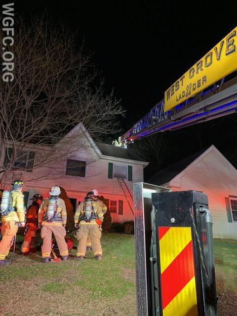 WGFC's Ladder 22 in position at a chimney fire in London Grove Township's Sullivan Station development, assisting Avondale 23.  Longwood FC's RIT is shown standing by.