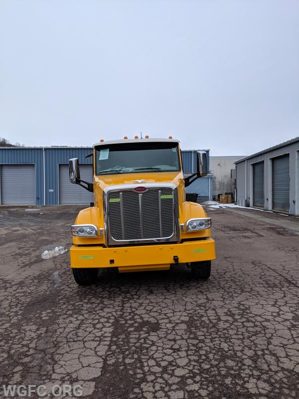 The commercial chassis is a 567 Peterbilt.