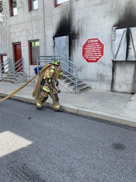 Stretching the initial attack line from the Engine to the front door