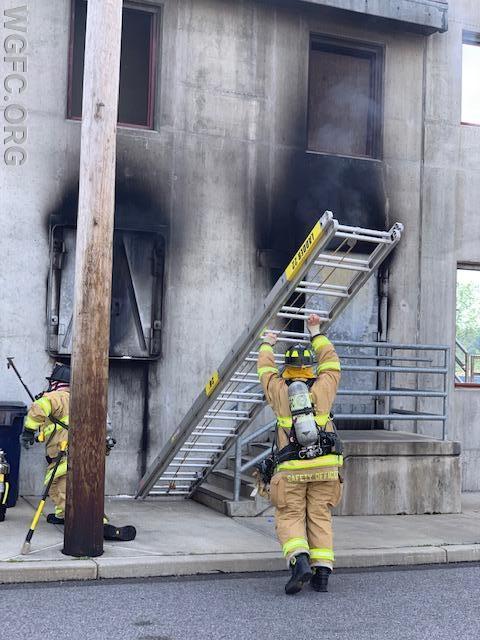 Ladder 22's crew sets ground ladders