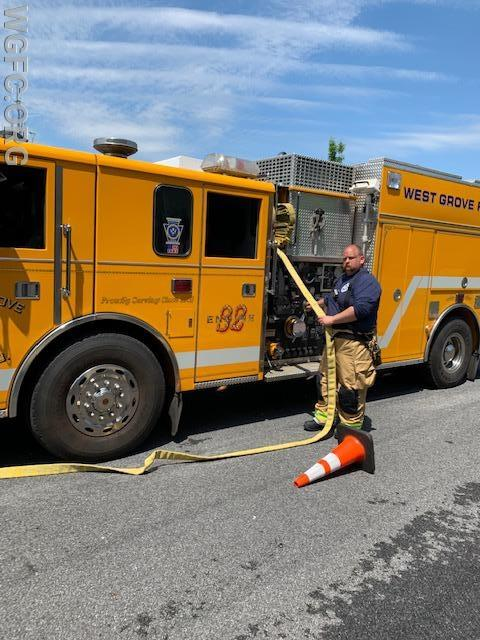 Driver Josh Hawk operates Engine 22-3 as the first due engine, awaiting the command to charge the attack line