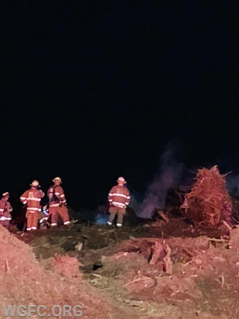 WGFC firefighters observe a large pile of construction debris burning in London Britain Township