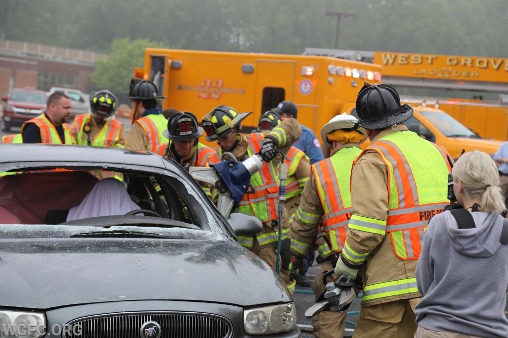 With a patient safely covered, crews use the Jaws of Life to open jammed doors