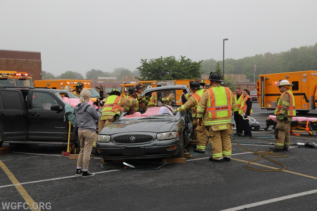 Crews lift off the roof of the car, providing easier access to patients in the car.