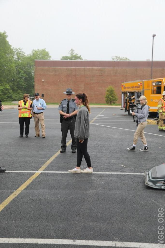 A student driver is interviewed by the State Police