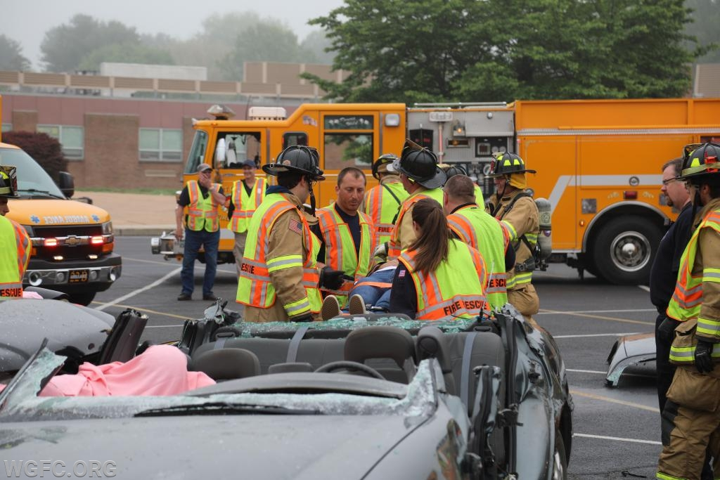 Crews carry the last patient from the badly damaged vehicle