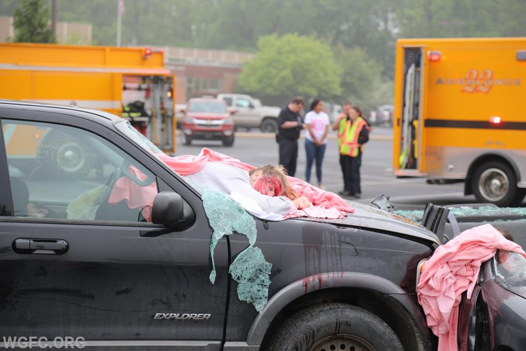 The purpose of the mock crash is to demonstrate the reality of distracted and drunk driving.  Making up victims to ""