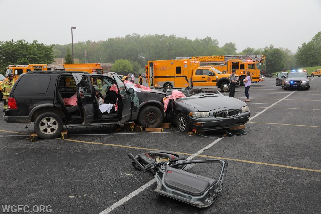 The aftermath of the mock crash shows two badly damaged vehicles with victims inside