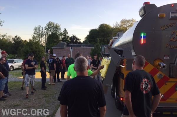 Members are shown how to operate the automatic portable tank lowering device.