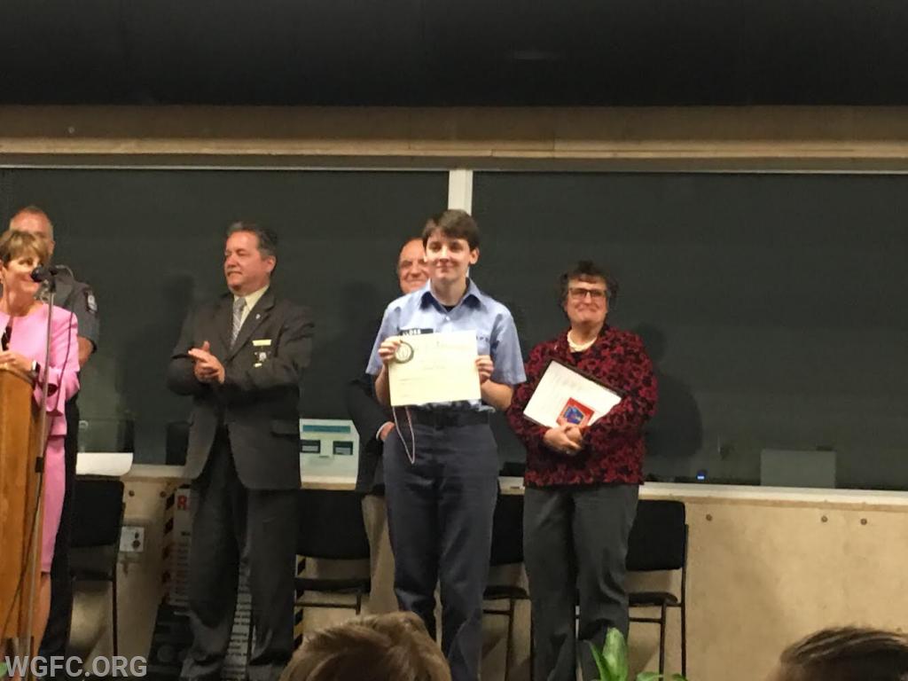 Cadet Kloss receiving her certificate at graduation.