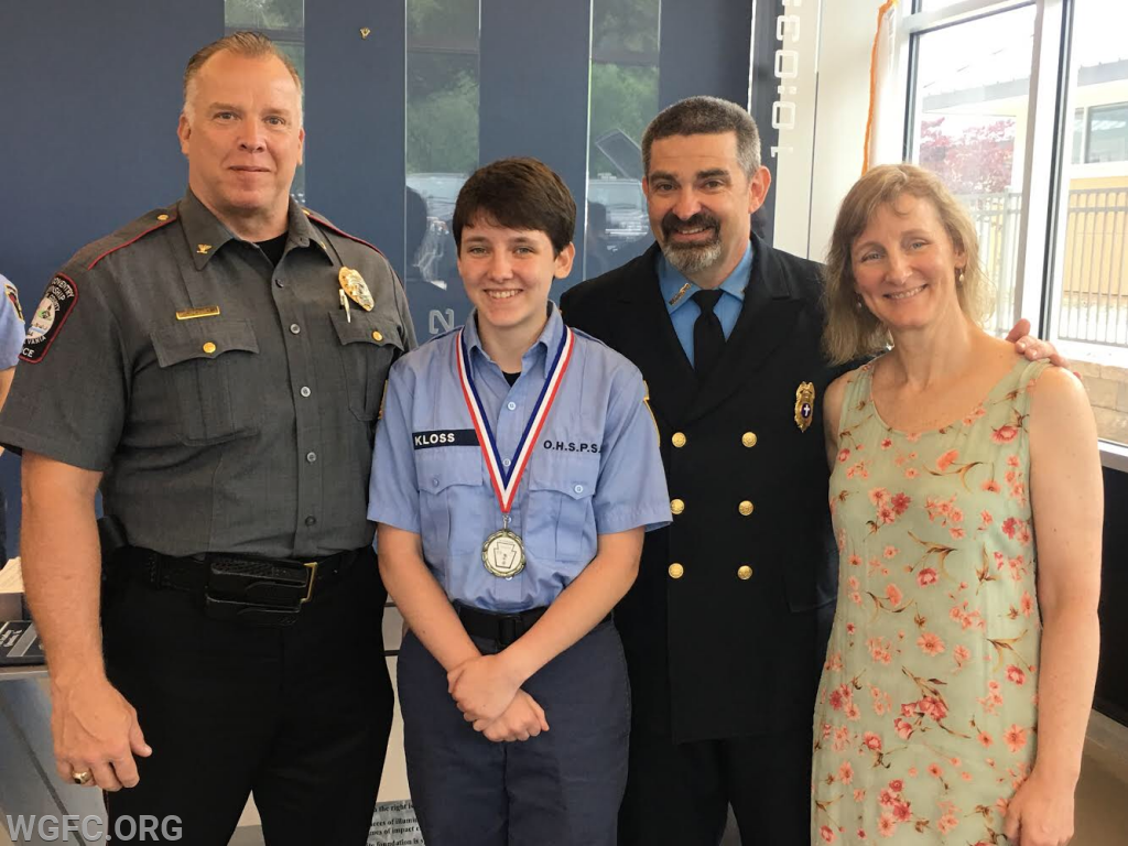 Chester County Police Chiefs' Association Presidet William Mossman with the Kloss family.