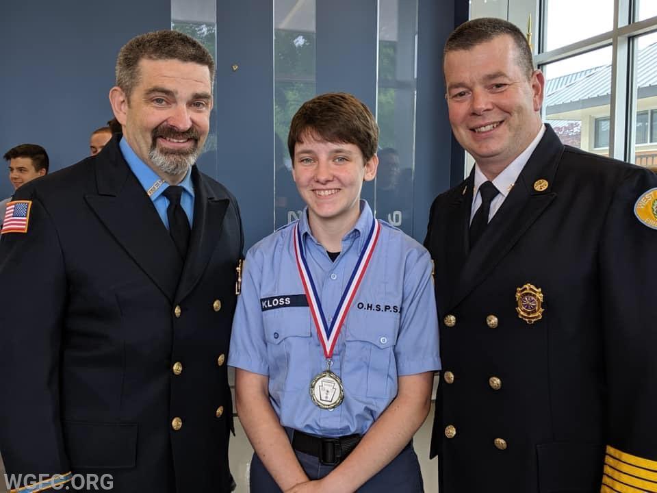 Chaplain FF/EMT Kloss, Cadet Kloss, and Assistant Chief Felker.