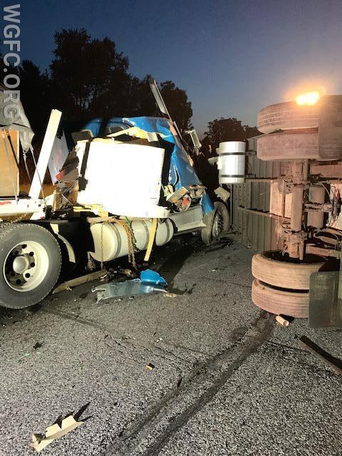 The truck on the left hit the truck on the righ, which had previously crashed and was on its side blocking northbound Route 1.  The large roll of aluminum that crushed the cab is sitting in the center of the truck, just above the leaking fuel tanks