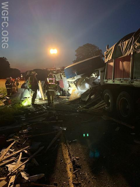 Another view of the destroyed vehicles and the scene