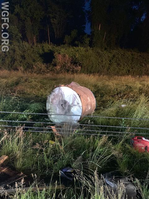 This nearly 10,000 pound roll of aluminum cross the median wires, thrown by the force of the crash