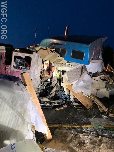 After extrication, this photo shows the cabe of the second truck -- the sleeper is fully destroyed, and the large roll of aluminum is deep inside the cab.  The drivers seat is visible at center