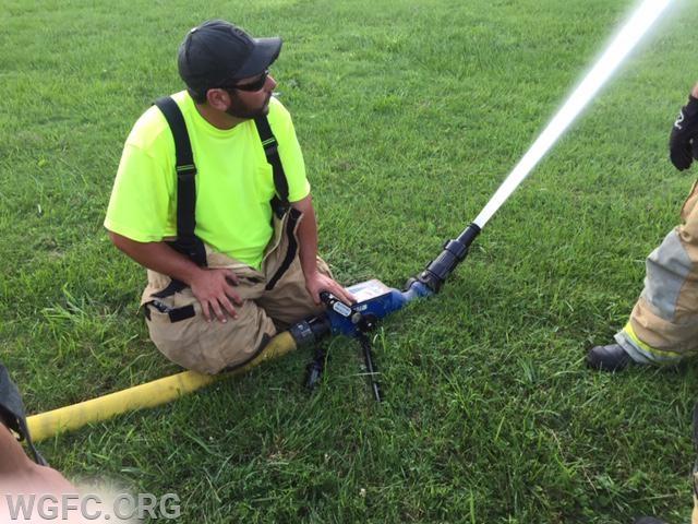 Firefighter Mike Predmore operates a portable blitz gun.