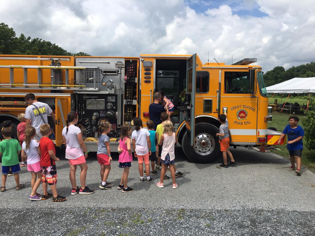 Capt. O'Connell helping children with Engine tour