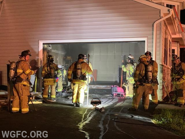 Firefighters at the scene of the fire in the garage.