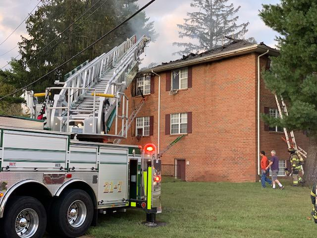 Millcreek's Ladder is set up on the west side of the fire building.