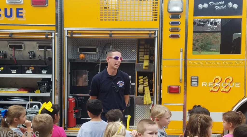 Students listen to fire safety program