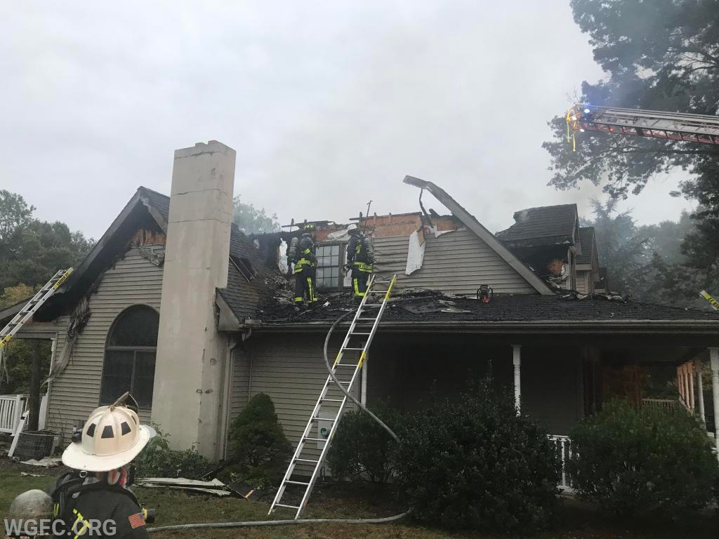 Significant damage is seen from the B (or North) side of the home