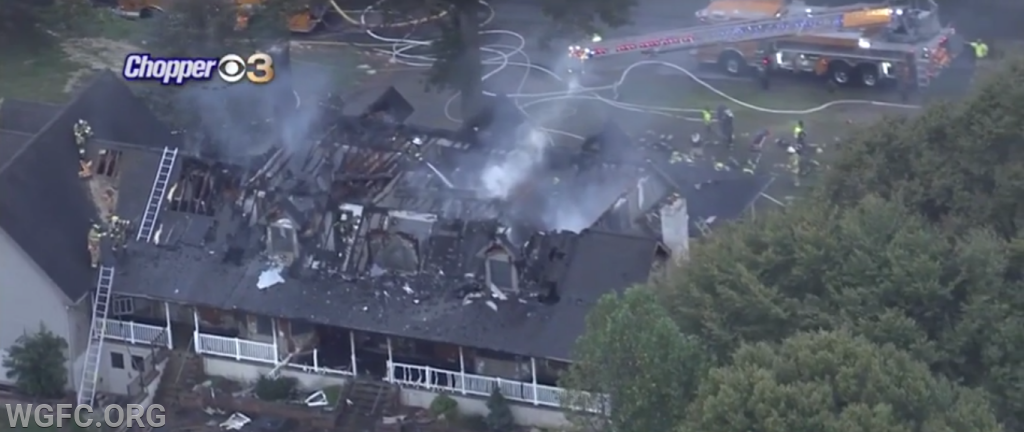 As dawn arrives, this shot from KYW News Chopper 3 shows the extensive damage to the roof and second floor.
