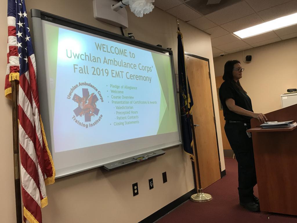 Director of the EMT program, Christina Casey, addresses the graduating class.