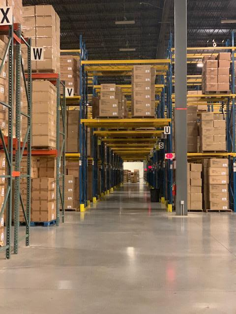 The size of the warehouse and the volume of inventory is apparent in this photo.