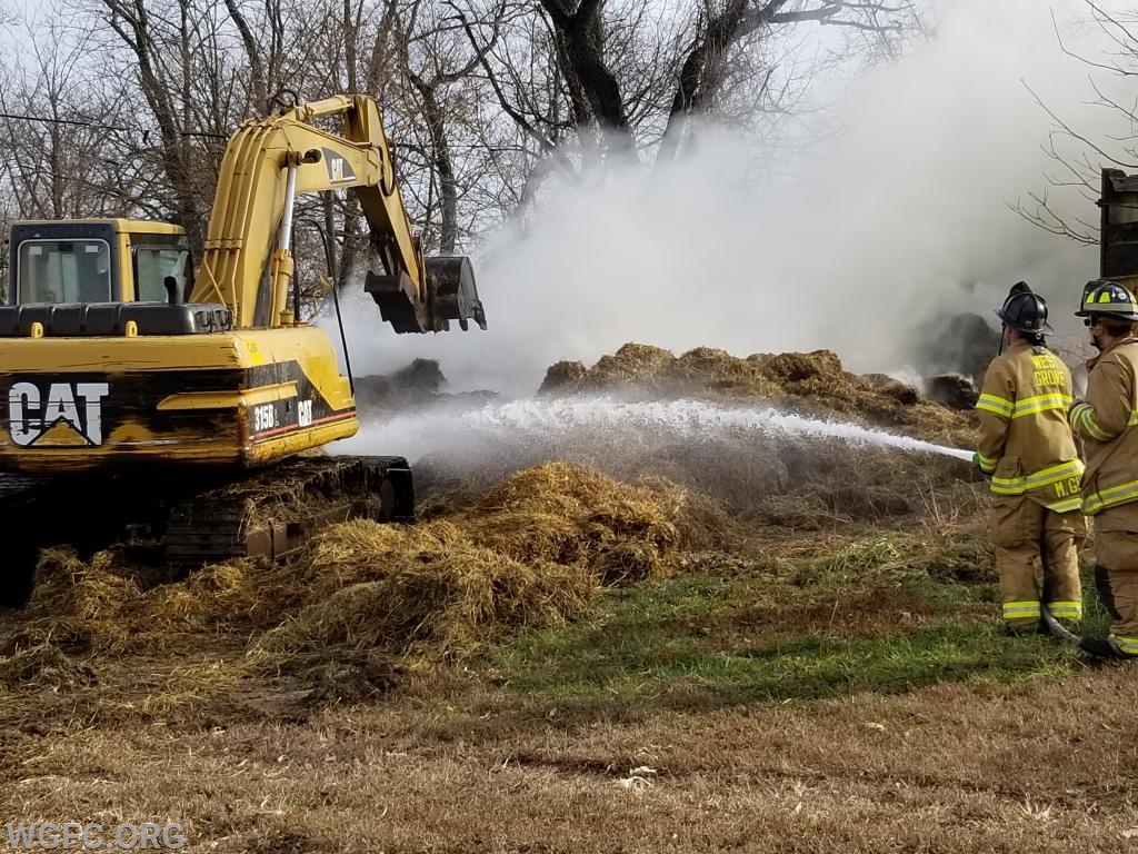 Fighting hay bale fires involves time, water, and equipment.