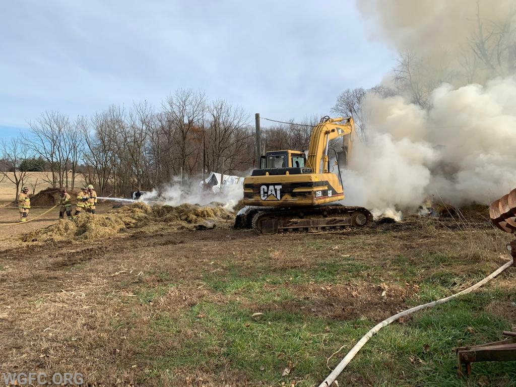 Break it up, spread it out, put it out -- that is the successful method for fighting hay bale pile fires.