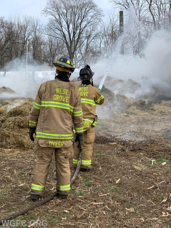 WGFC firefighters operate a hand line as crews work to extinguish the fire.
