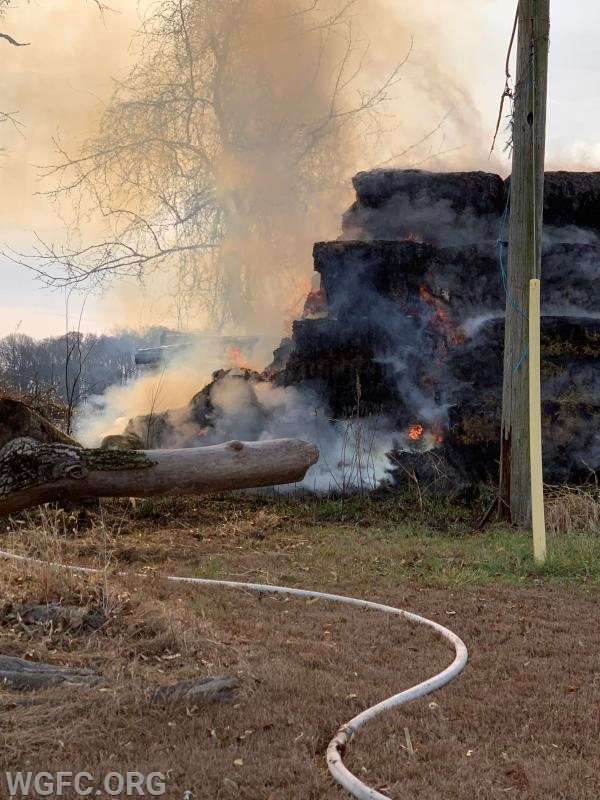 The large pile of hay bales was burning upon arrival.