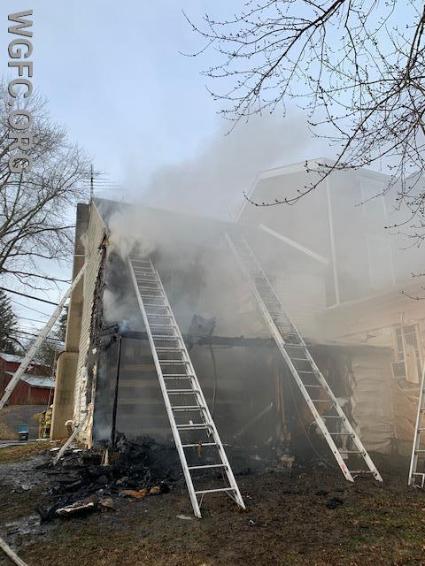 Ladders are positioned around the home