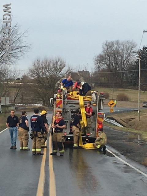 "WGFC crews picking up 1250' of 5"" supply line"